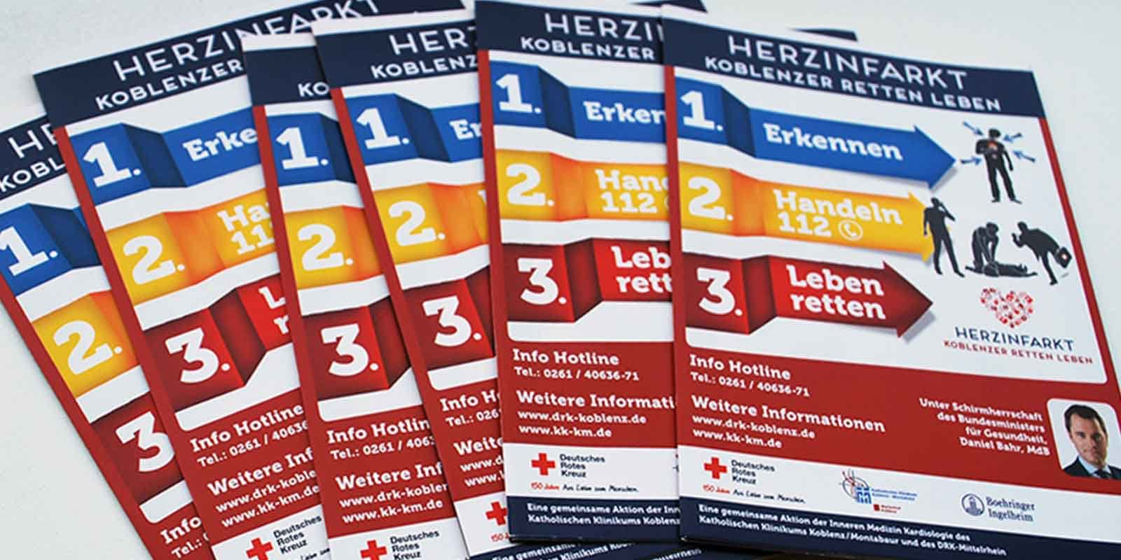 Stack of Brochures showing Creative Direction, Custom Design and Wordpress Development, Marketing for DRK German Red Cross