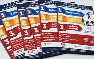 Stack of Brochures showing Creative Direction, Custom Design and Wordpress Development, Marketing for DRK German Red Cross Featured Image